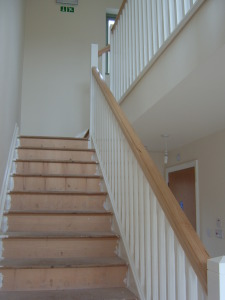 Solid maple hand rail and new stairs in new build property